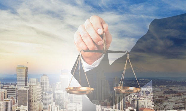 Businessman holding  justice scale on background