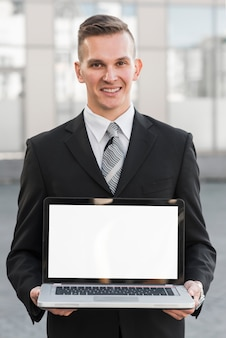 Businessman holding laptop template