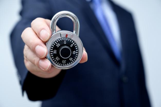 Businessman holding a lock.