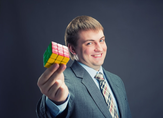 Businessman holding rubik cube in his hands