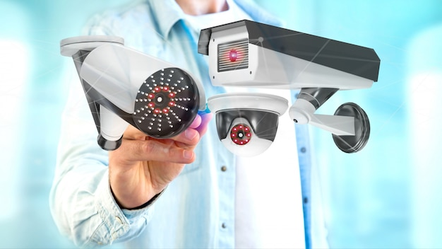 Businessman holding a security camera system and network connection - 3d rendering