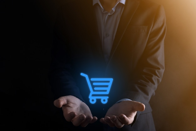 Businessman holding shopping cart