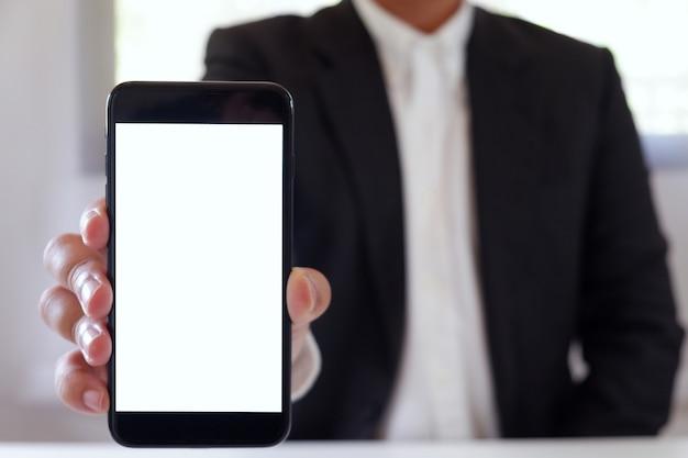 Businessman holding smartphone copy space