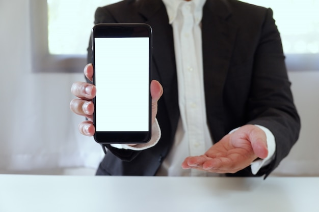Businessman holding smartphone copy space