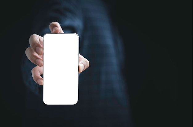 Businessman holding smartphone with blank screen frame template  for add advertisement and text.