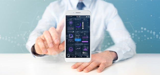 Businessman holding smartphone with user interface data on the screen isolated