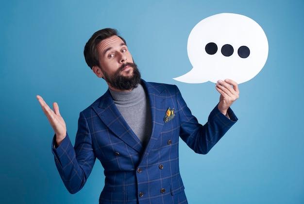Businessman holding a speech bubble