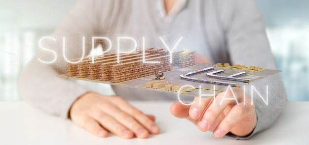 Businessman holding a supply chain title with a warehouse on background 3d rendering
