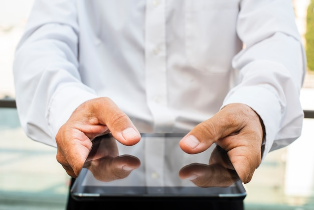 Businessman holding tablet in hands