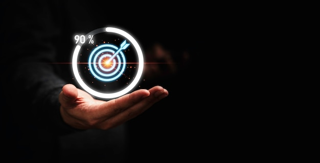 Businessman holding target dartboard with download icon progress for business achievement  concept.