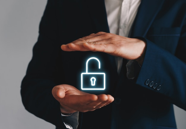 Businessman holding unlock icon
