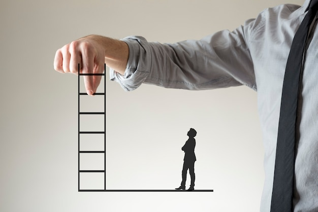 Businessman holding up a ladder between his fingers as a small silhouette of a second stands watching below