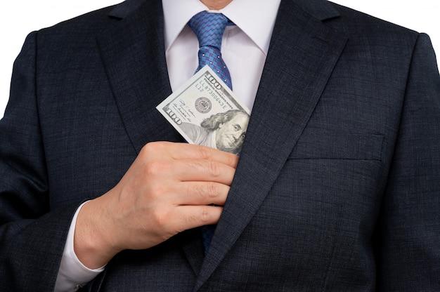 米ドルを手で押しのビジネスマン。