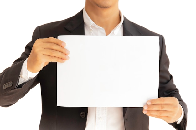Businessman holding white clear paper board in hands isolated in clipping path.
