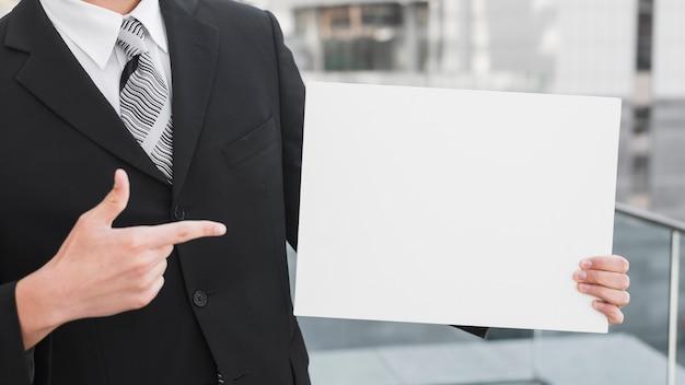 Businessman holding white paper