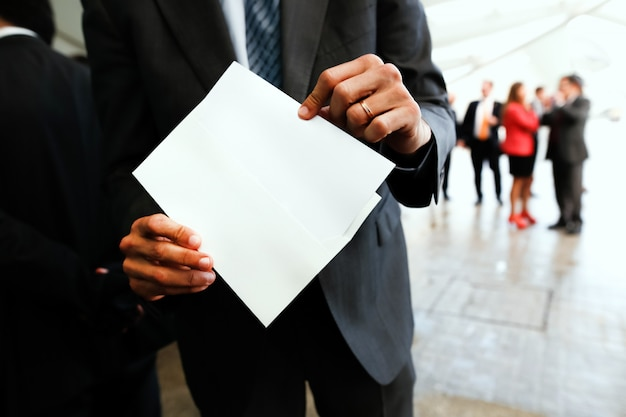 Businessman holding an white paper