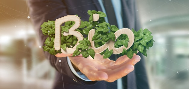 Businessman holding wooden logo bio with leaves around 3d rendering