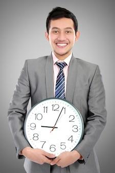 Businessman holds clock