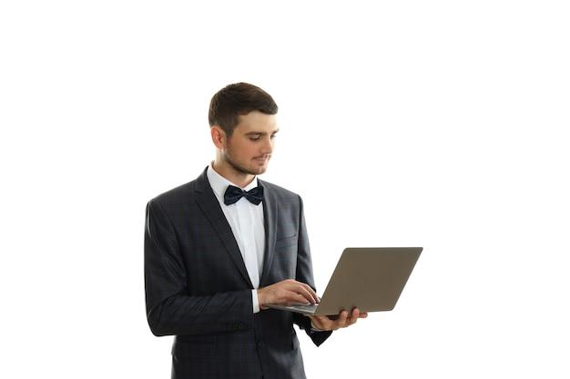 Businessman holds laptop, isolated on white background.