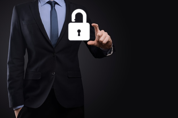 Businessman holds an open padlock icon on his palm.unlocking a virtual lock. business concept and technology metaphor for cyber attack, computer crime, information security and data encryption.