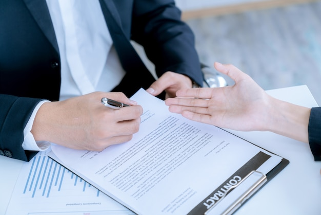 Businessman and home buyer customer had agree deal and signed in the contract sale of real estate