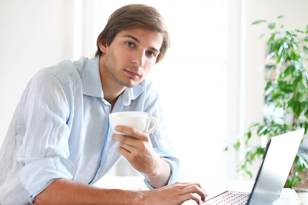 Businessman at home using laptop