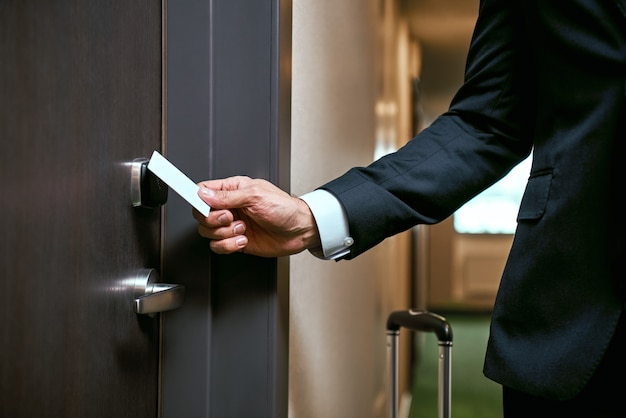 Businessman in hotel. close-up of using keycard to open the door or scan keycard open door for chance