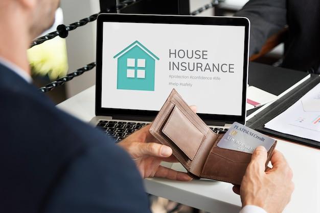 Uomo d'affari sull'assicurazione sulla casa
