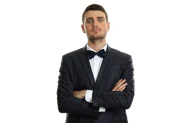 Бизнесмен в классическом костюме на белом фоне.