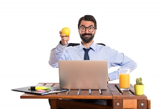 Businessman in his office holding an apple
