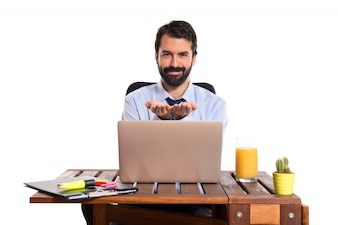 Businessman in his office holding
