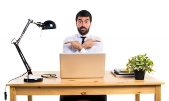 Businessman in his office  pointing to the laterals having doubts