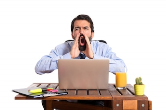Businessman in his office shouting