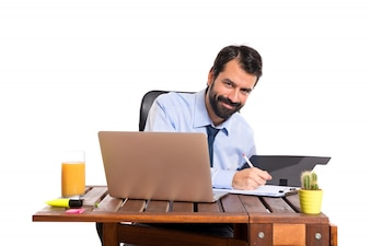 Businessman in his office with his folder