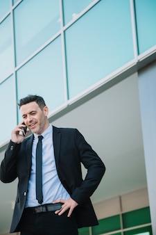 Businessman in suit calling