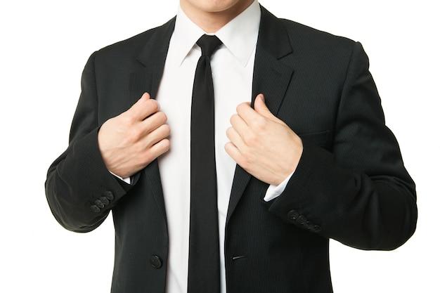 白い背景で隔離のスーツのビジネスマン