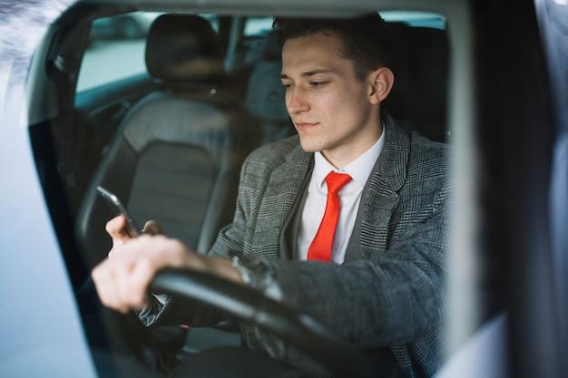 Businessman inside of a car