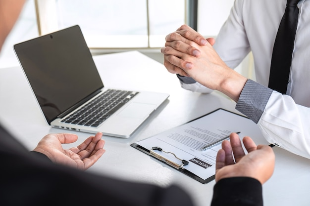 Businessman interview considers a resume conversation about profile of candidate