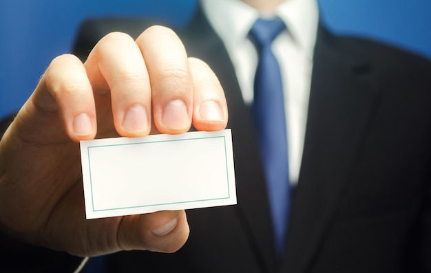 Businessman introduces himself with a business card