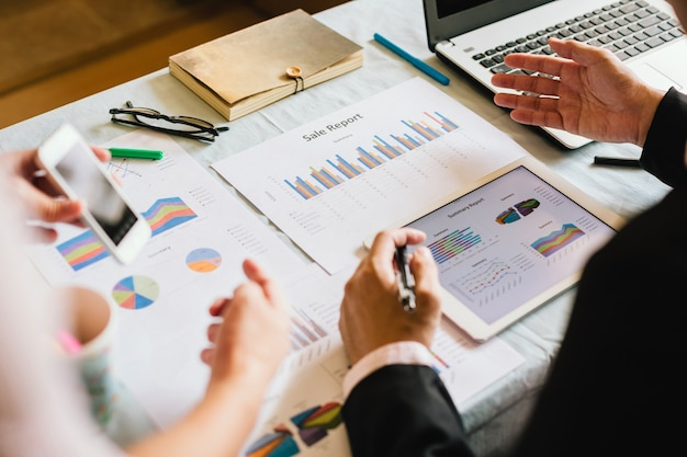 Businessman investment consultant analyzing company financial report balance with document