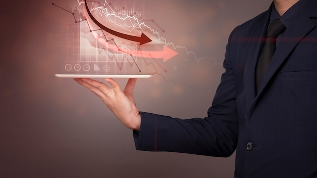 Businessman is analyzing economic data collapse, world economic crisis concept