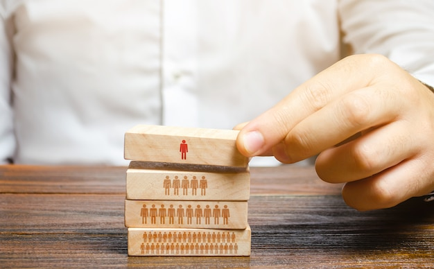 Businessman is building a hierarchy in a company. leadership, teamwork, feedback in the team