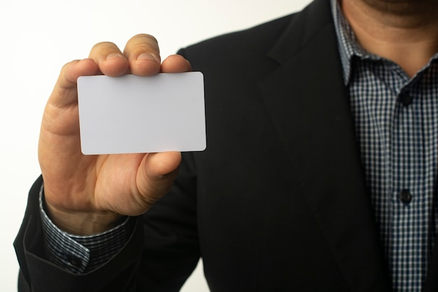 Businessman is holding a white business card.