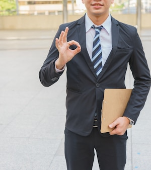 Businessman is showing ok sign.
