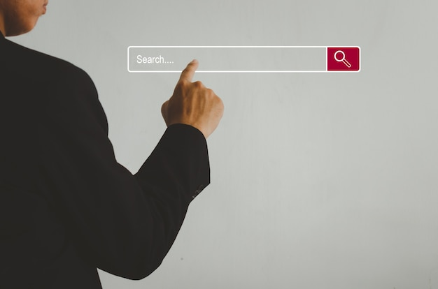 Businessman is touching a search on a virtual screen.searching information network concept with copy space. internet search page computer touch screen.