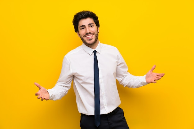 Businessman on isolated yellow  proud and self-satisfied