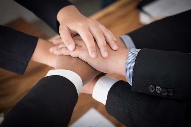 Businessman joining hand, business team touching hands together -