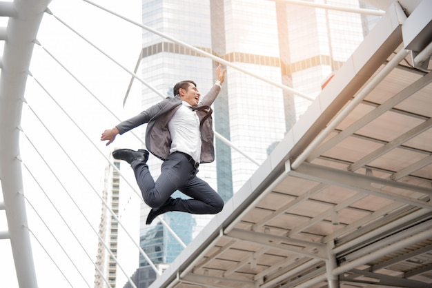 Businessman jumping in happy mood concept, business concept, lifestyle concept