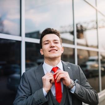 Businessman knoting tie