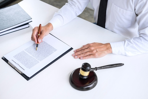 Businessman or lawyer working on a documents, legal law, advice and justice concept